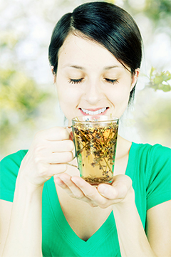 A woman sips on a Herbal Tea.
