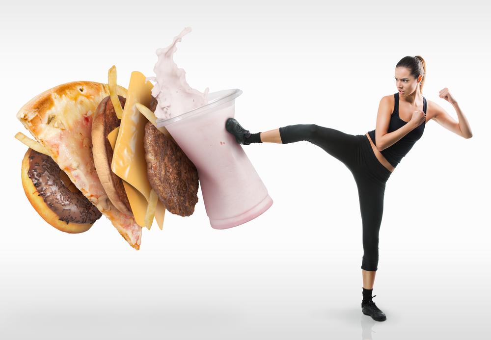 Woman kung-fu kicking junk food