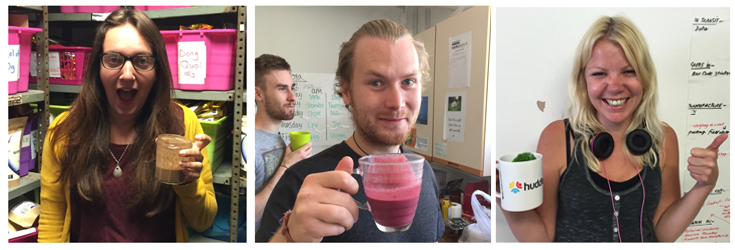 This is a photo banner of 3 Indigo Team members drinking pink, green and brown smoothies