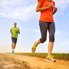 Man and Woman Jogging Running in Sports Clothes in the Sunset
